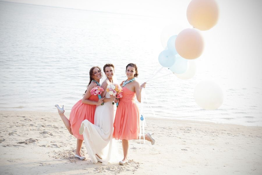 Bride and maids on the beach